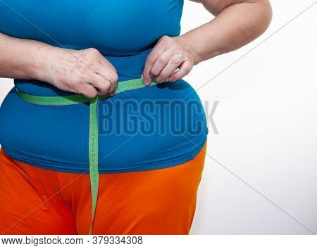 Measure The Waist With A Centimeter Tape. The Problem Of Excess Weight. Full Belly And Folds. Hands
