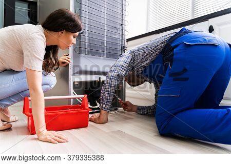 Refrigerator Appliance Or Fridge Repair Service By Technician