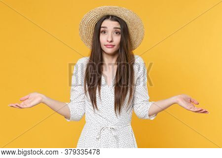 Perplexed Bewildered Young Brunette Woman Girl In White Dress Hat Posing Isolated On Yellow Backgrou