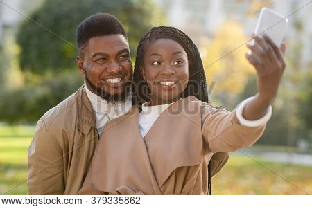 Beautiful Happy Afro Couple Taking Self-portrait, Capturing Their Happy Moments Together While Walki