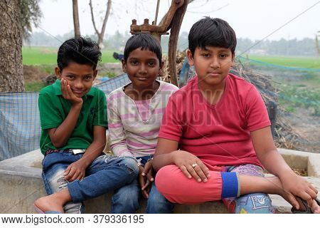 KUMROKHALI, INDIA - FEBRUARY 24, 2020: Portrait of children in Kumrokhali village, West Bengal, India