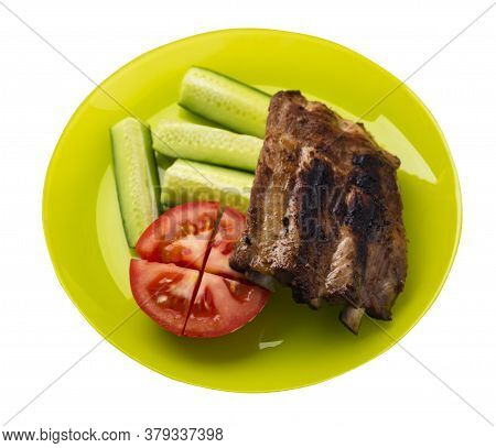 Grilled Pork Ribs With Sliced Cucumbers And Tomatoes On Yellow Plate. Pork Ribs Isolated On White Ba