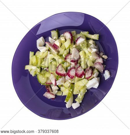 Salad With Cucumbers And Eggs On Purple Plate Isolated On White Background .healthy Food . Vegetaria