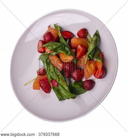 Salad With Strawberries, Pineapple And Spinach On Light Gray Plate. Fruit Vegetarian Salad Isolated