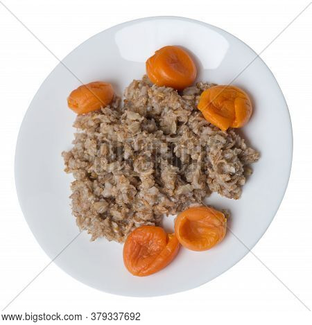 Healthy Food .rzhanye Flakes With Dried Apricots On A Plate. Rainy Flakes Isolated On White Backgrou