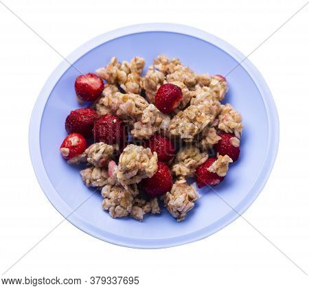Muesli With Strawberries On Light Blue Plate Isolated On White Background.healthy Breakfast.diet Foo