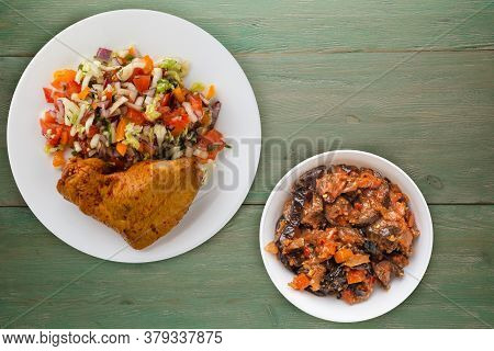 Chicken Wing With Vegetable Salad On A Green Wooden Background. Chicken Wing With Vegetables On A Pl
