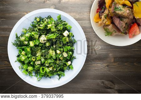 Vegetarian Food . Onions And Dill On Blue Plate With Vegetarian Salad On Black Wooden Background. He