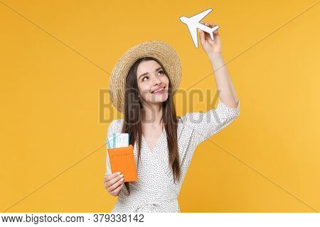 Pretty Young Woman Girl In White Dress Hat Posing Isolated On Yellow Background. Passenger Traveling