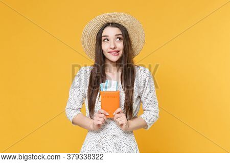 Pensive Young Woman Girl In White Dress Hat Posing Isolated On Yellow Background. Passenger Travelin