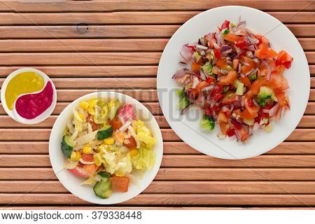 Vegan Food. Salad From Vegetables Pepper, Tomato, Onions, Broccoli On A White Plate. Vegan Salad On