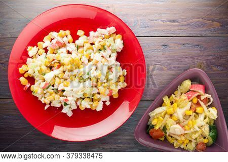 Crab Salad On Red Plate With Vegetarian Salad Top View. Crabs Salad On Purple Wooden Background