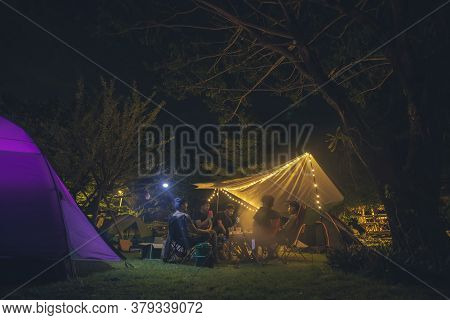 Camping Tent In Night Forest, Group Friends Camping Tent Together.