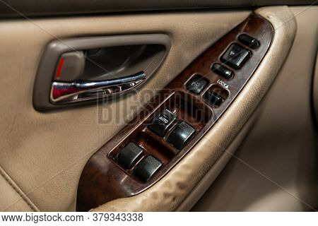 Novosibirsk/ Russia - August 01 2020: Subaru Outback, Interior Of Modern Car. Side Door Buttons: Win