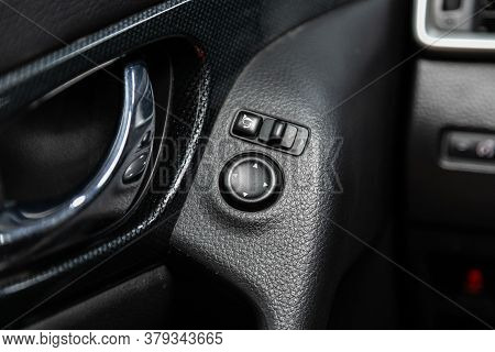 Novosibirsk/ Russia - August 01 2020: Nissan X-trail, Close-up Of The   Side Mirror Setting Buttons.