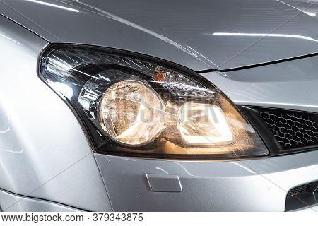Novosibirsk/ Russia - August 01 2020: Renault Koleos, Silver Car Headlights. Exterior Detail. Close