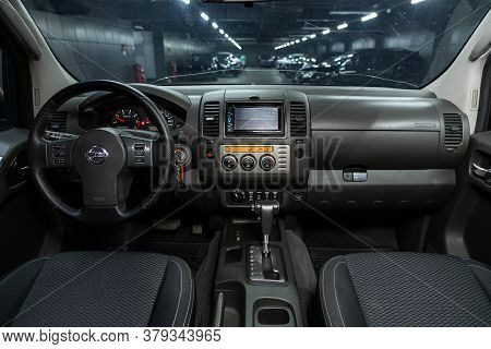 Novosibirsk/ Russia - August 01 2020: Nissan Navara, Dark Car Interior - Steering Wheel, Shift Lever