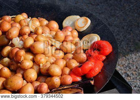 Vegan Cuisine: Grilled Baby Potatoes Served In A Metal Frying Pan. Street Festival Food.