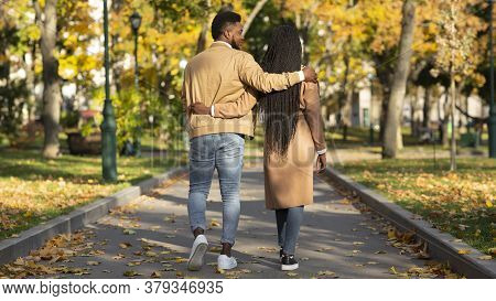 Romantic Walk. Rear View Of Couple In Love Walking In Autumn Park And Embracing Each Other, Panorama