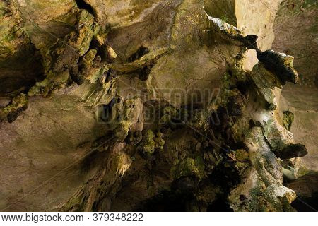 Hike To The Cave. Ancient Stone Cave Stalactites And Stalagmites