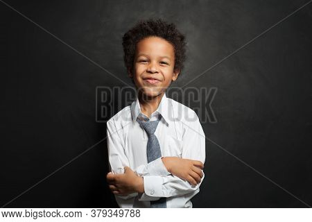 Happy Black Child Student Boy With Crossed Arms Smiling On Black, Portrait
