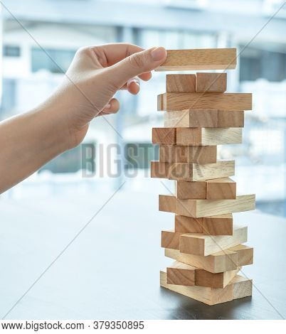 Hand Holding Blocks Wood Game, Concept Risk Of Management And Strategy Plan, Growth Business Success