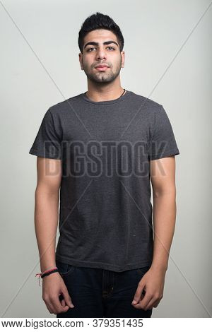 Portrait Of Young Handsome Bearded Indian Man