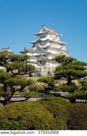 Himeji, Japan, 06/11/19. Vertical Portrait View Of Snow White Himeji Castle Complex In A Crystal Blu