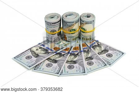 A large roll of hundred dollar bills knitted by a  rubber band isolated on white background