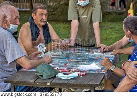 Older Gentlemen Play Cards