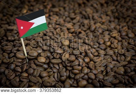 Jordan Flag Sticking In Roasted Coffee Beans. The Concept Of Export And Import Of Coffee