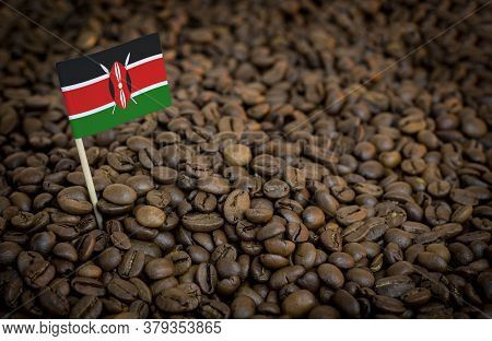 Kenya Flag Sticking In Roasted Coffee Beans. The Concept Of Export And Import Of Coffee