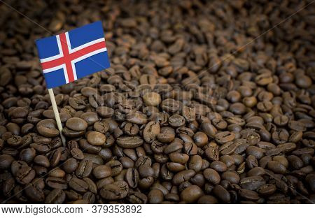 Iceland Flag Sticking In Roasted Coffee Beans. The Concept Of Export And Import Of Coffee