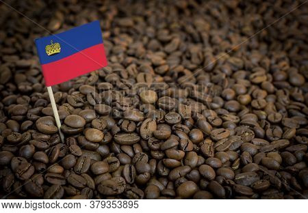 Liechtenstein Flag Sticking In Roasted Coffee Beans. The Concept Of Export And Import Of Coffee