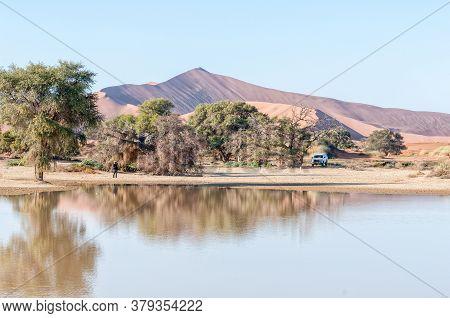 Sossusvlei, Namibia - June 11, 2011: View Accross Sossusvlei, Filled With Water, Towards Deadvlei. B