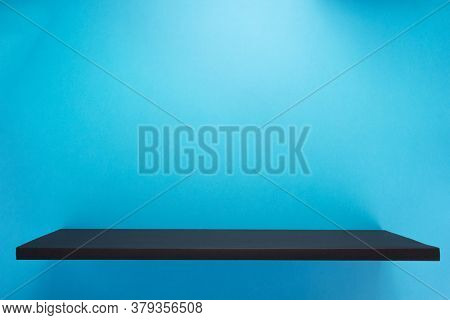 book shelf at abstract wall background