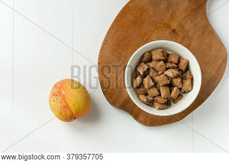 Crispy Cereal And Chocolate Pillows With Milk. Brakefast With Chocolate Pillows And Peach On White A