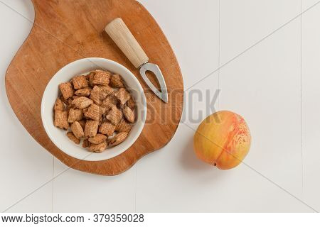 Crispy Cereal And Chocolate Pillows With Milk. Brakefast With Chocolate Pillows And Peach With Knife