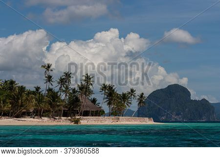 Traditional Bungalow On White Sand Beach Of Tropic Island