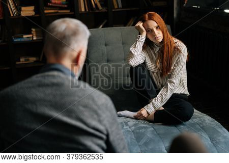 Frustrated Young Red-haired Lady In Casual Clothing Is Having Therapy Session With Psychologist. Mal
