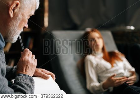 Unrecognizable Red-haired Young Woman Patient Talking About Problems While Lying In Comfortable Sofa