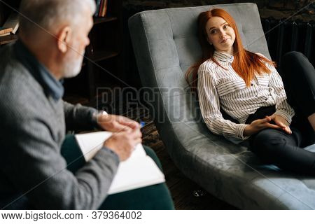 Happy Attractive Redhead Young Woman Patient Is Telling About Her Mental Health While Lying In Comfo