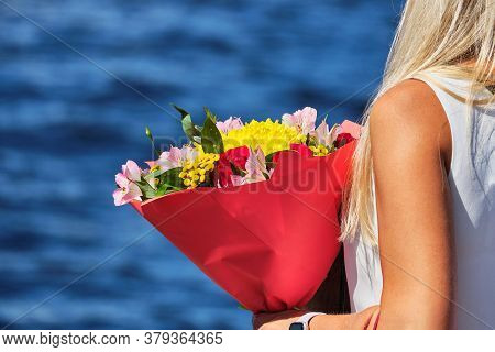 Beautiful Summer Bouquet Of Flowers Is Held By A Girl.