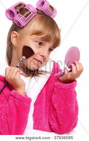 Little girl in pink bathrobe