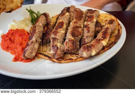 Cevapcici Or Cevapi, Bosnian Dish Prepared On The Barbecue And Served With Lepinja Bread. Popular Ba