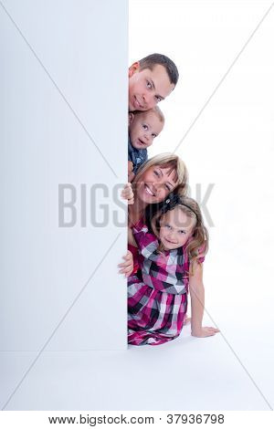 Smiling Family Peek Out