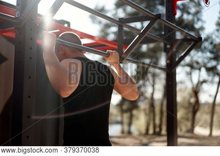 Unrecognizable Caucasian Men Pull-up Outdoor Workout Cross Training Morning Back View Stretching Arm