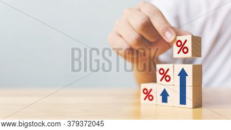 Hand Arranging Wood Block Stacking As Step Stair With Sign Percent And Arrow Up Symbol. Interest Rat