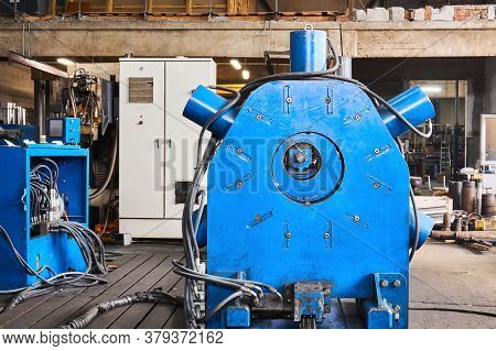 Industrial Interior With Various Equipment And A Huge Lathe With Steady Rest In The Foreground