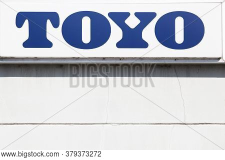 Aarhus, Denmark - August 25, 2019: Toyo Logo On A Wall. Toyo Is A Tire And Rubber Products Company B